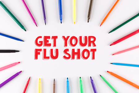 Multi Colored Pen written GET YOUR FLU SHOT Stock Photo
