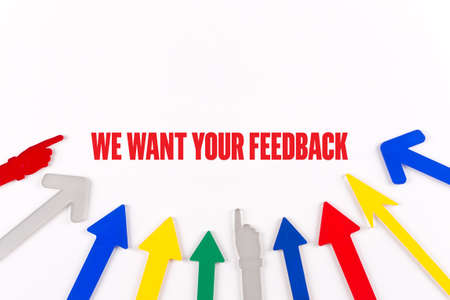 Colorful Arrows Showing to Center with a word WE WANT YOUR FEEDBACK Stock Photo