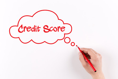 customer records: Hand writing Credit Score on white paper, View from above