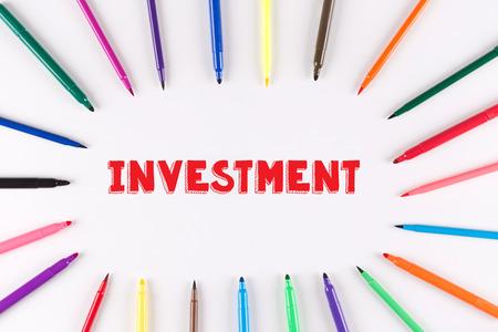 multi colored: Multi Colored Pen written INVESTMENT Stock Photo