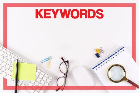 backlink: High Angle View of Various Office Supplies on Desk with a word KEYWORDS