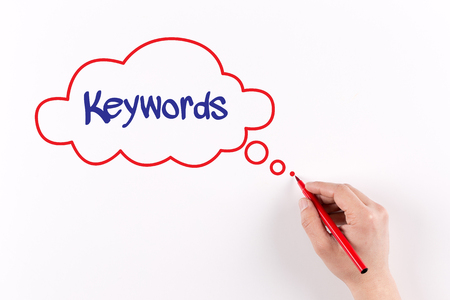 metadata: Hand writing Keywords on white paper, View from above Stock Photo