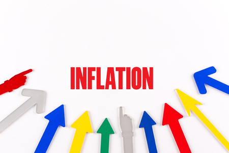 price uncertainty: Colorful Arrows Showing to Center with a word INFLATION Stock Photo