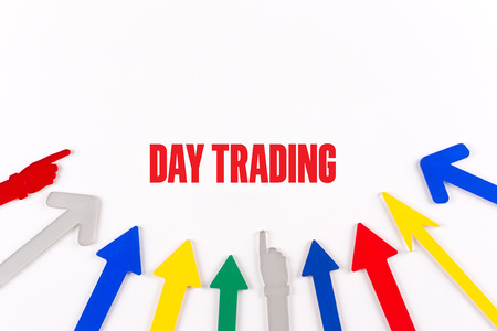 stock quotations: Colorful Arrows Showing to Center with a word DAY TRADING Stock Photo