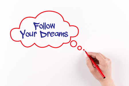 phrase: Follow Your Dreams phrase on white paper, View from above Stock Photo