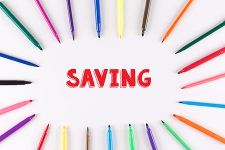 multi colored: Multi Colored Pen written SAVING Stock Photo