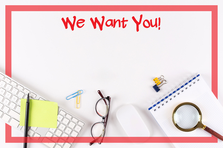 lay forward: High Angle View of Various Office Supplies on Desk with a word We Want You!