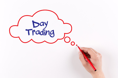 stock quotations: Hand writing Day Trading on white paper, View from above