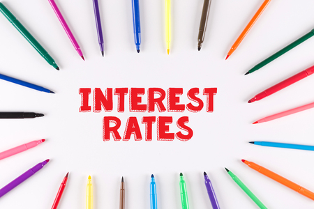 interest rates: Multi Colored Pen written INTEREST RATES