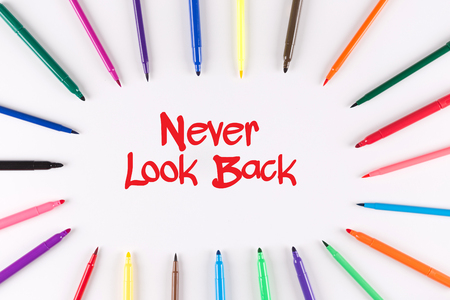 forthcoming: Multi Colored Pen written Never Look Back phrase