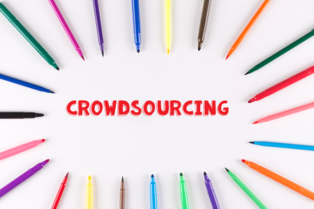 crowdsourcing: Multi Colored Pen written CROWDSOURCING Stock Photo