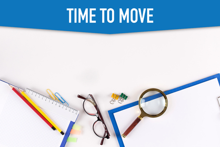 lay forward: High angle view of various office supplies on desk with a word TIME TO MOVE