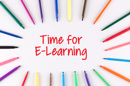 instances: Time For E-Learning written on white background with multi colored pen Stock Photo