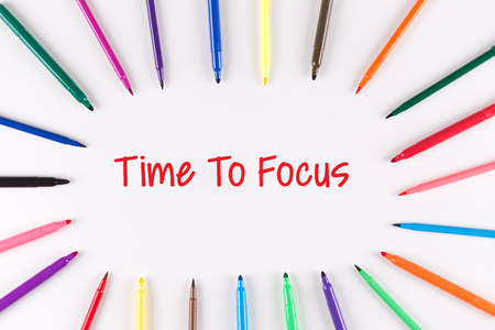 distinctness: Time To Focus written on white background with multi colored pen