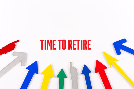 retire: Colorful arrows showing to center with a phrase TIME TO RETIRE Stock Photo