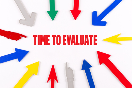 reevaluation: Colorful arrows showing to center with a phrase TIME TO EVALUATE Stock Photo