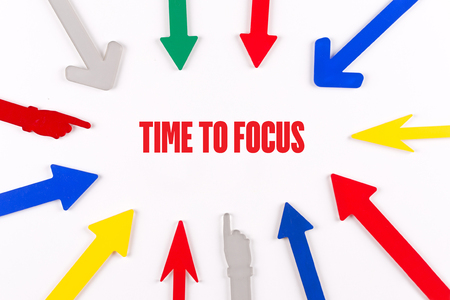 distinctness: Colorful arrows showing to center with a phrase TIME TO FOCUS Stock Photo