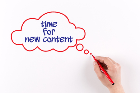 keywords link: Hand writing Time For New Content on white paper, view from above Stock Photo