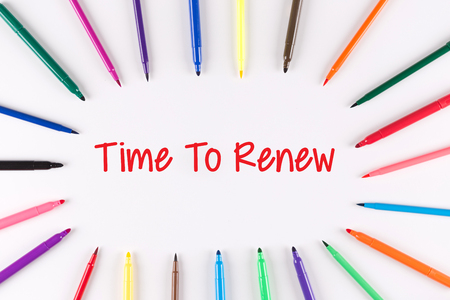 Time To Renew written on white background with multi colored pen
