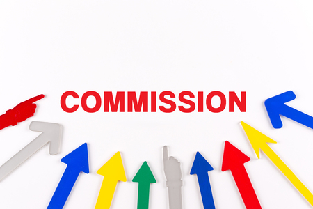 commission: Colorful arrows showing to center with a word COMMISSION Stock Photo