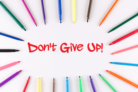 commitment committed: Multi Colored Pen written Dont Give Up! phrase