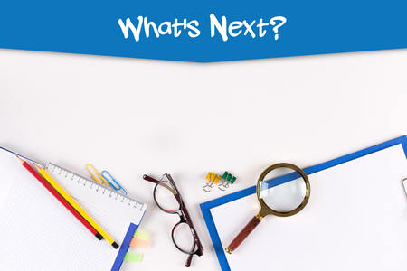 lay forward: High Angle View of Various Office Supplies on Desk with a phrase Whats Next? Stock Photo