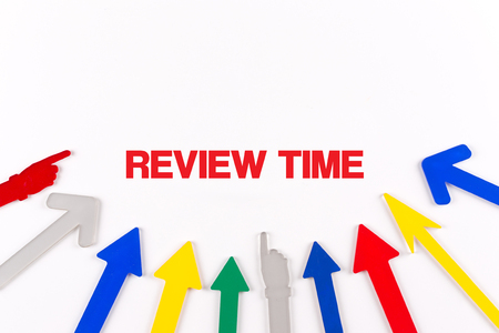 reassessment: Colorful arrows showing to center with a word REVIEW TIME Stock Photo