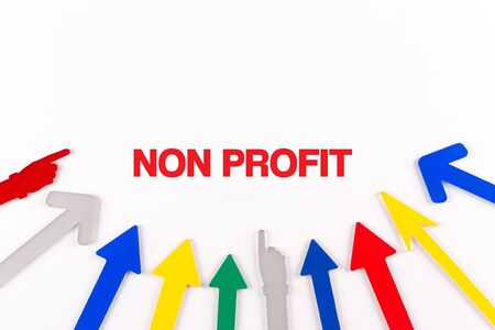 non profit: Colorful arrows showing to center with a word NON PROFIT Stock Photo