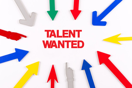 human potential: Colorful arrows showing to center with a word TALENT WANTED Stock Photo