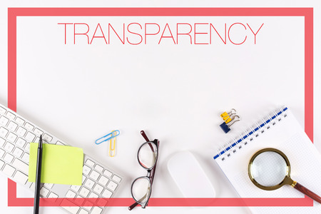 comply: High angle view of various office supplies on desk with a word TRANSPARENCY