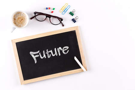 lay forward: Future word on chalkboard with coffee cup and eyeglasses, view from above
