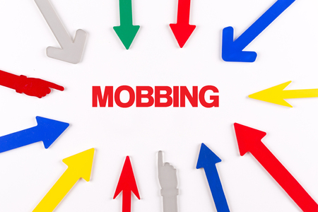 mobbing: Colorful arrows showing to center with a word MOBBING Stock Photo