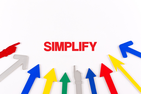 simplification: Colorful arrows showing to center with a word SIMPLIFY Stock Photo