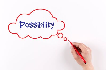 possibility: Hand writing Possibility on white paper, view from above Stock Photo