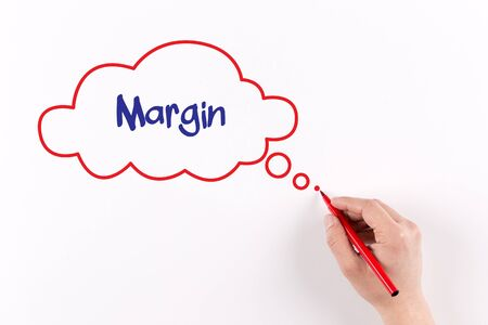 margen: Hand writing Margin on white paper, view from above