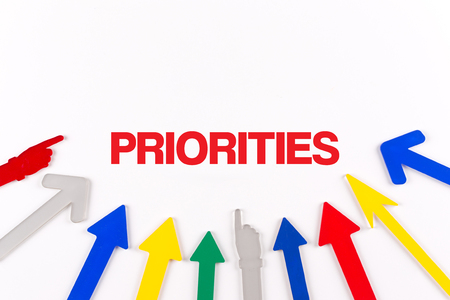 priorities: Colorful arrows showing to center with a word PRIORITIES
