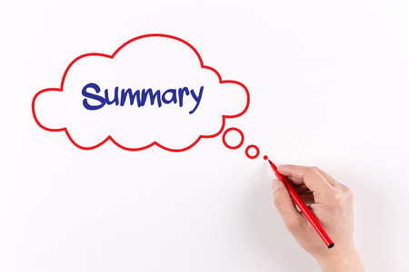 Hand writing Summary on white paper, view from above