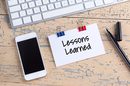 learned: Paper note with text Lessons Learned