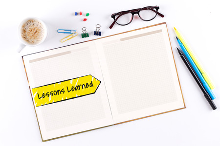 summarize: Lessons Learned text on notebook with copy space Stock Photo