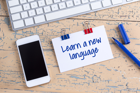 fluency: Paper note with text Learn a new language Stock Photo