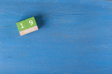 19 years old: March 19, Cube calendar on wooden surface with copy space Stock Photo