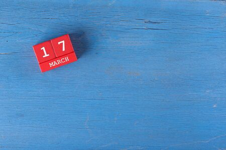 17 year old: March 17, Cube calendar on wooden surface with copy space Stock Photo