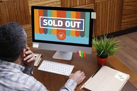 recommendations: Man using computer with SOLD OUT concept on screen
