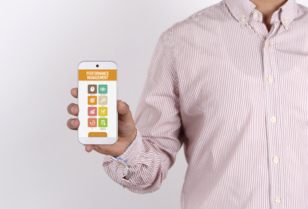 documented: Man showing smartphone Performance Management on screen