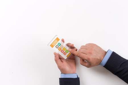 coined: Hand Holding Transparent Smartphone with Performance Management screen