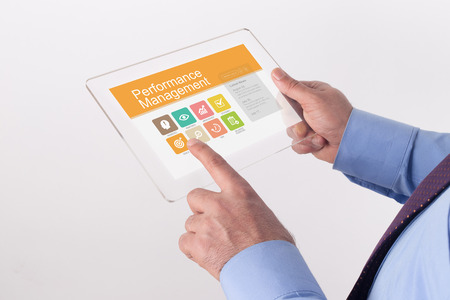 documented: Hand Holding Transparent Tablet PC with Performance Management screen Stock Photo