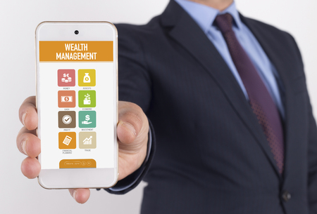wealth management: Man showing smartphone Wealth Management on screen