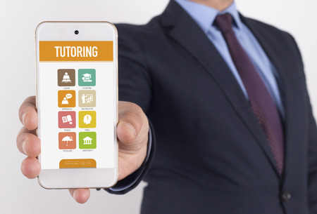 indoctrination: Man showing smartphone Tutoring on screen
