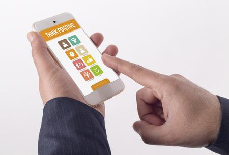 enterprising: Man showing smartphone Think Positive on screen
