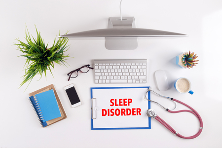 sleep disorder: Office desk with SLEEP DISORDER paperwork and other objects around, top view